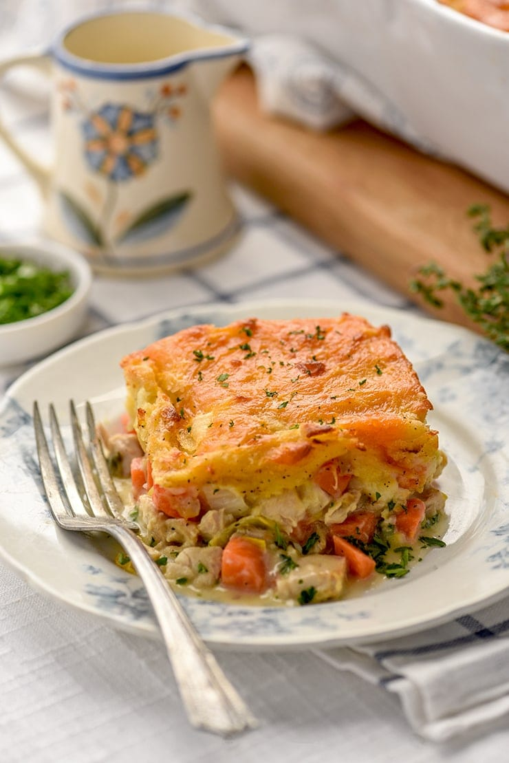 piece of chicken cottage pie on a china late with blue flowers