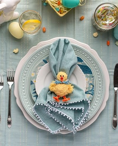 easter dinner table setting with yarn chick napkin rings