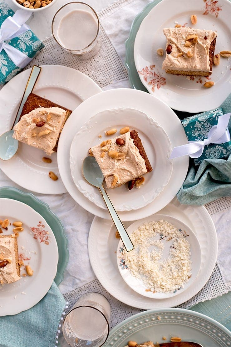 slices of peanut butter sheet cake on pretty white and aqua plates