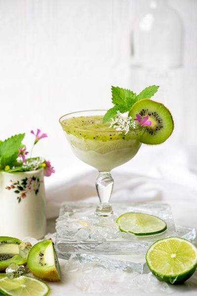 frozen kiwi daiquiri in a gold rimmed glass