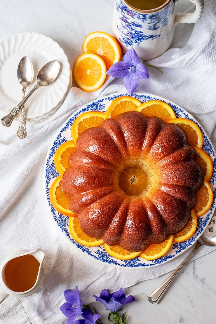 top down photo of a bundt cake on a bed of sliced oranges