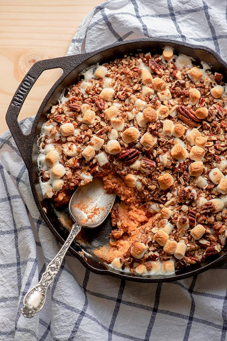 closeup of sweet potato casserole with a serving missing