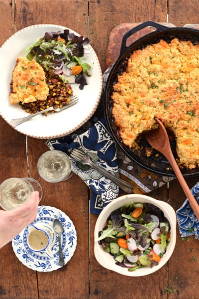 lentil casserole in cast iron pan on farm table