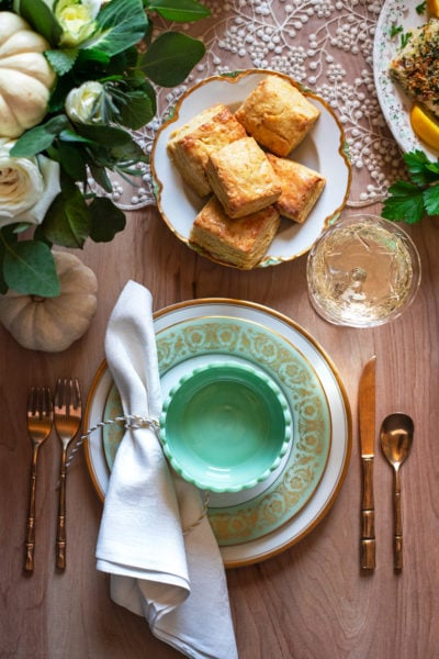 cornmeal biscuits above a china place setting